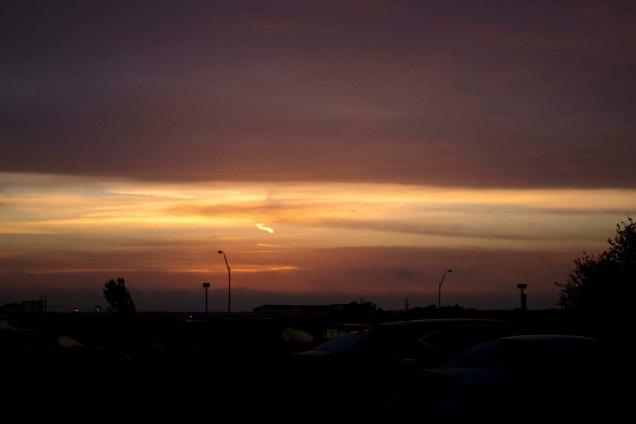 sunset overlooking cars